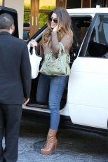 Khloe Kardashian Keeps In Touch On The Go
